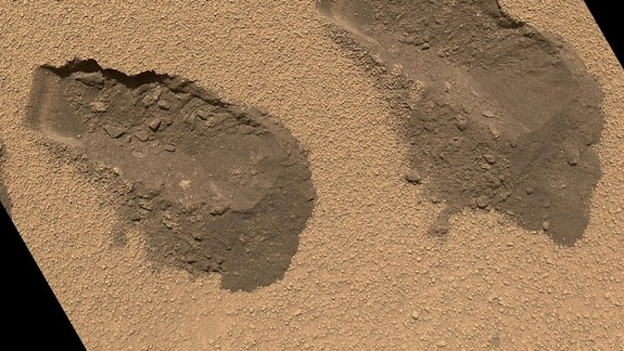 This is a view of the third (left) and fourth (right) trenches made by the 1.6-inch-wide (4-centimeter-wide) scoop on NASA's Mars rover Curiosity in October 2012. The image was acquired by the Mars Hand Lens Imager (MAHLI) on Sol 84 (Oct. 31, 2