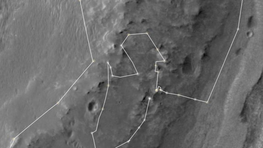 "This map shows the route driven by NASA's Mars Exploration Rover Opportunity during a reconnaissance circuit around an area of interest called ""Matijevic Hill"" on the rim of a large crater."