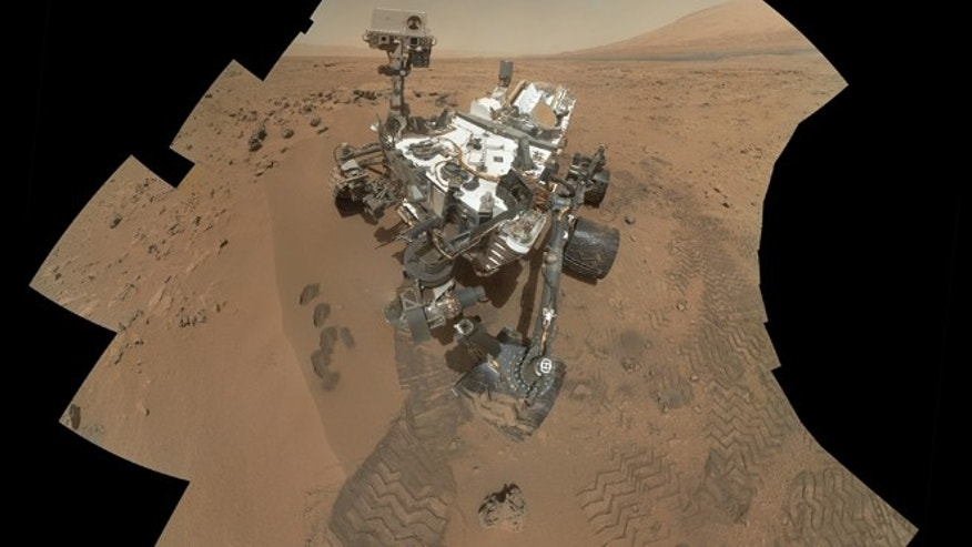 This image released by NASA shows the work site of the NASAs rover Curiosity on Mars.