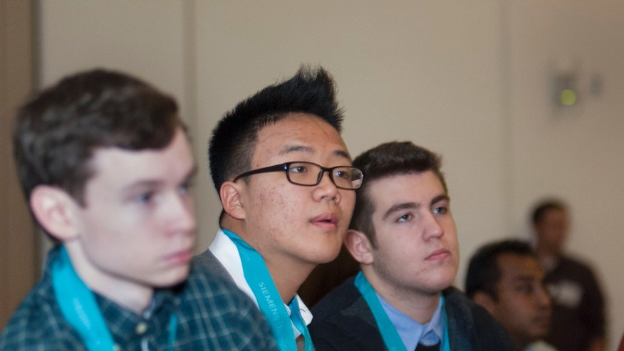 Dec. 4, 2012: William Gil, one of a trio of students from Hewlett, N.Y., who will share a prize in an annual Siemens science competition for their research on a protein involved in tumor formation.