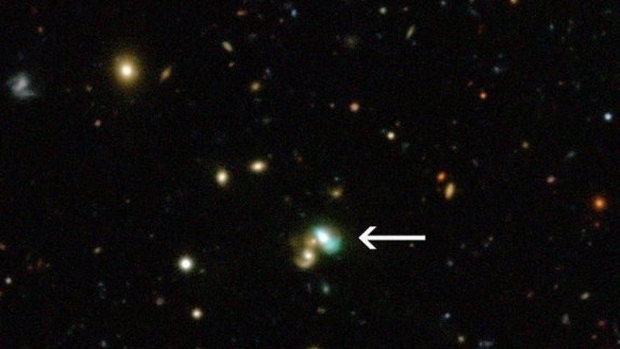 This view from the Canada-France-Hawaii Telescope shows a close-up of the sky around a very unusual green object called J224024.1?092748 or J2240. It is a bright example of a new class of objects that have been nicknamed green bean galaxies. Im