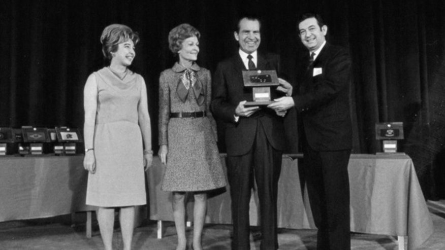 Dec. 3, 1969: President Richard Nixon presents moon rocks to then Governor of Alaska Keith Miller, right, as Pat Nixon, second left, and Diana Miller look on at the Governors Conference in Washington.