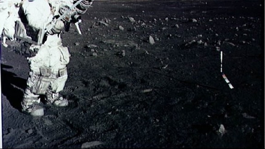 Astronaut Harrison Schmitt collects lunar rake samples during an Apollo 17 moonwalk in December 1973.