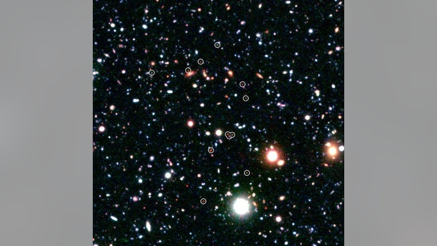 Science vs. religion: Religion proponents say the universe is too finely tuned for life to not involve a god, while science proponents say we know how the universe formed from nothing. Shown here, a group of galaxies forming very early in the u