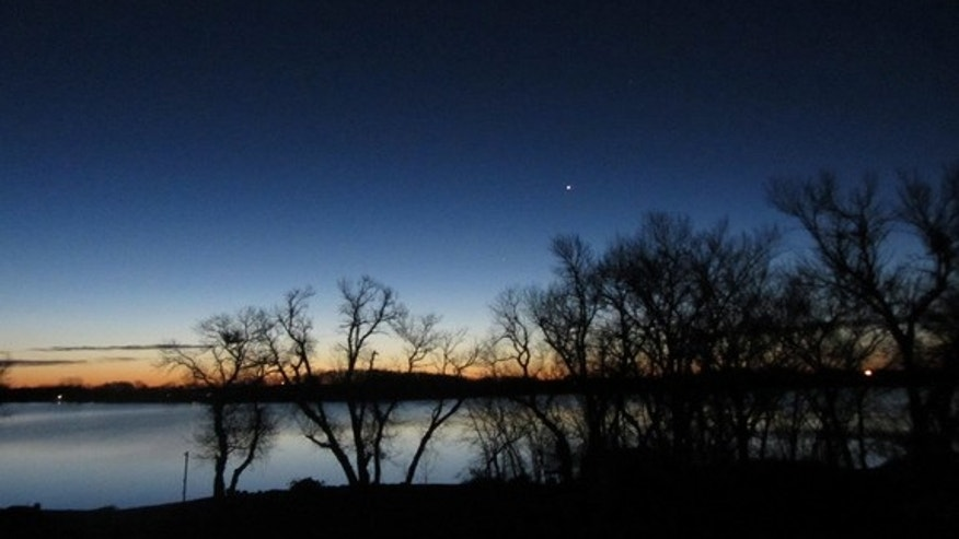 "Night sky observer Brenda Steffes sent in this photo of the planet Venus shining in the night sky on Dec. 3, 2012. She writes: ""This photo was taken from my back porch in Hendricks, MN."""