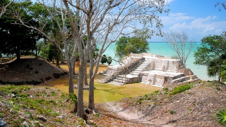 Mayan ruins ovelook a scenic vista in Belize.