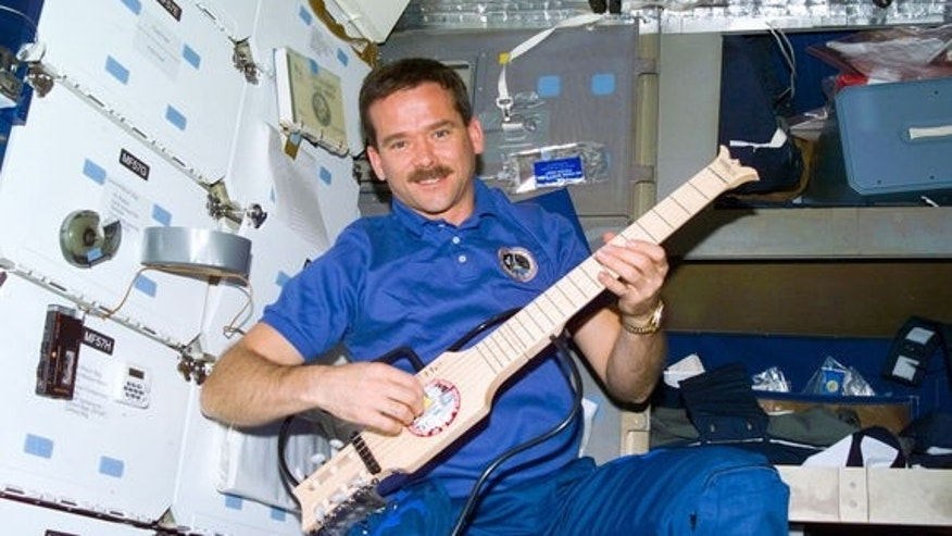 On his first spaceflight in 1995, Chris Hadfield toted a foldable SoloEtte guitar to the Mir space station. He plans to perform on the ISS with a Larrivée Parlor acoustic guitar.