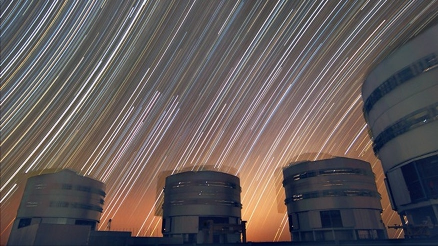 The rotating sky above ESO's Very Large Telescope at Paranal. This long exposure shows the stars rotating around the southern (left) and northern (right) celestial poles.