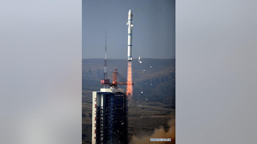 A Long March 2C rocket carrying two satellites blasts off from the Taiyuan Satellite Launch Center in China on Oct. 14, 2012.