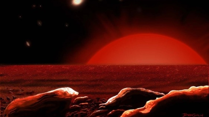 Artist's conception of the view of a hypothetical planet around a distant red giant star. Our sun is expected to swell in a few billion years to first fry Earth then engulf it.