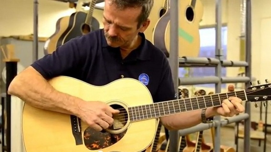 Canadian astronaut Chris Hadfield strums a Larrivée Parlor acoustic guitar similar to the one he will use aboard the International Space Station when he commands orbiting laboratory in 2013 during the Expedition 35 mission.