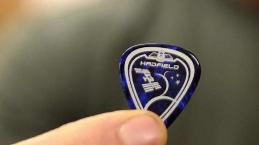 A close-up of the cosmic guitar pick to be used by Canadian astronaut Chris Hadfield during his Expedition 35 mission to the International Space Station in late 2012 and early 2013. The pick resembles Hadfield's Expedition 35 mission patch.