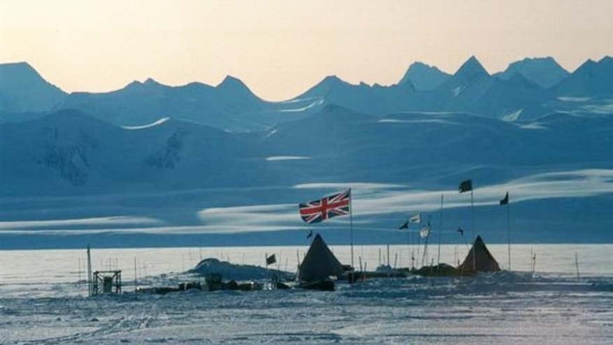 The Union Jack flies over a field camp at Lake Ellsworth. In the background are the Ellsworth Mountains, the highest range in Antarctica.