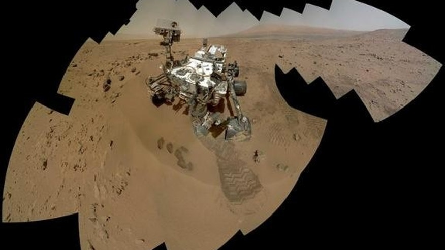 During its 84 and 85 day (sol) on Mars, Curiosity snapped this newest mosaic self-portrait.