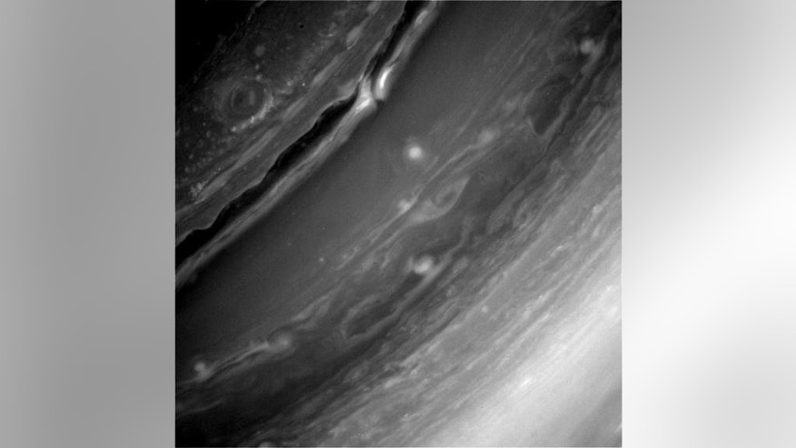 This image, captured by the Cassini orbiter on Christmas Eve (Dec. 24) and beamed to Earth on Dec. 26., shows details of Saturn's turbulent surface.