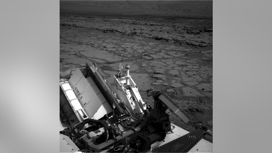 "Dec. 12, 2012: This image provided by NASA shows the Mars rover Curiosity at a pit stop, a shallow depression called ""Yellowknife Bay."""