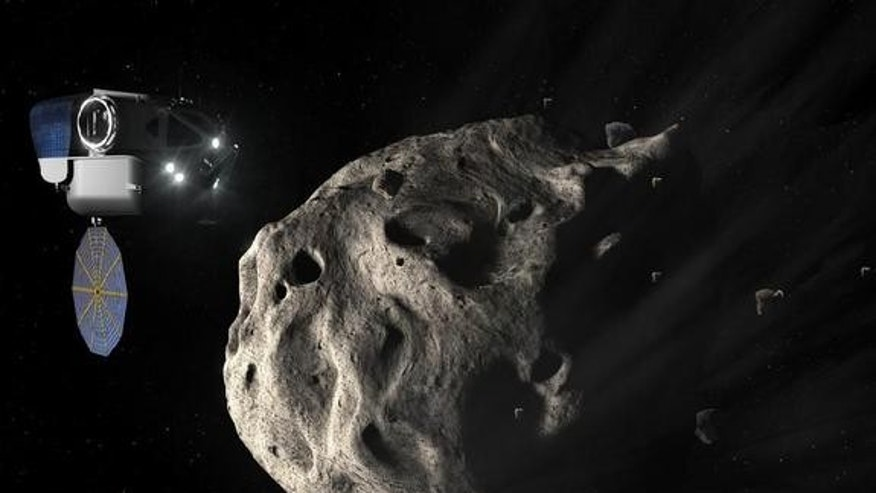 Twin Space Exploration Vehicles approach an asteroid with the Multi-Person Crew Vehicle docked to a habitat in the background.