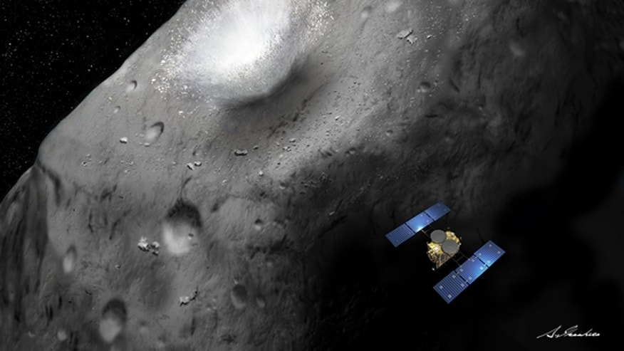 An artist's illustration of Japan's Hayabusa2 probe crashing an impactor into the asteroid 1999 JU3 ahead of sampling the space rock in 2018.