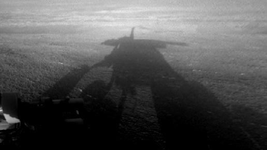 NASA's Mars Exploration Rover Opportunity captured this view of its afternoon shadow stretching into Endeavour Crater during the 3,051st Martian day, or sol, of Opportunity's work on Mars on Aug. 23, 2012.
