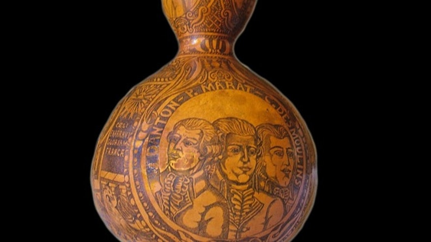 A gourd emblazoned with heroes of the French Revolution contained the blood of Louis XVI.