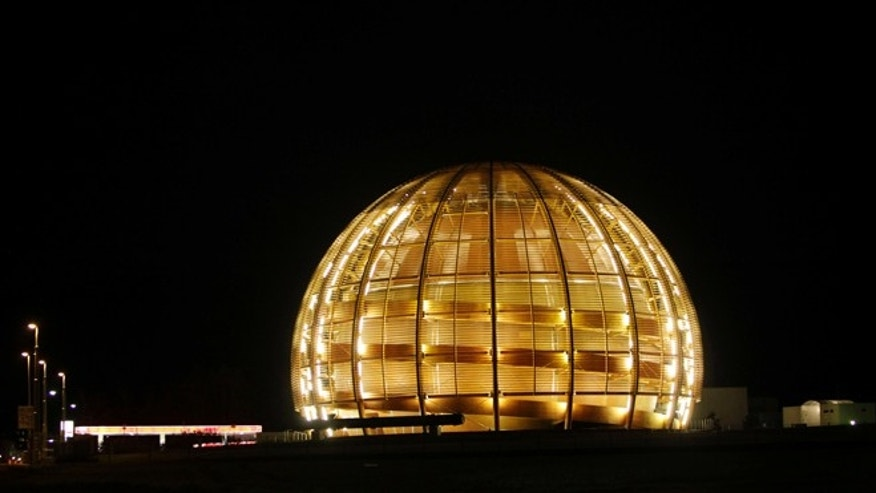 "March 30, 2010: The globe of the European Organization for Nuclear Research, CERN, is illuminated outside Geneva, Switzerland. The world's largest and most powerful atom smasher goes into a 2-year hibernation in March 2013, aiming to reach maximum energy levels that may lead to more stunning discoveries after hunting down the so-called ""God particle."""