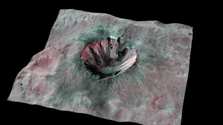 This composite-color view from NASA's Dawn mission shows Cornelia Crater, streaked with dark materials, on the giant asteroid Vesta