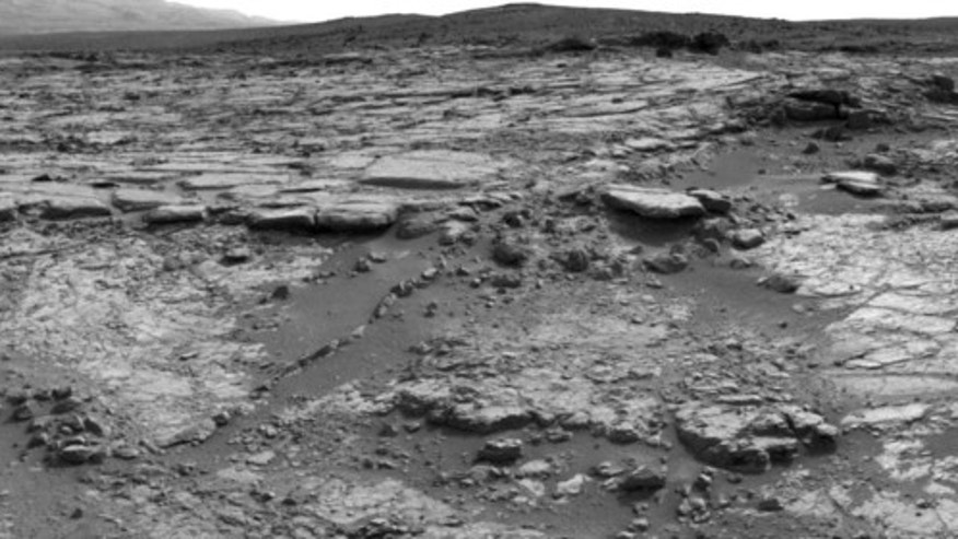 "The sinuous rock feature in the lower center of this mosaic of images recorded by the NASA Mars rover Curiosity is called ""Snake River."" Image taken Dec. 20, 2012."