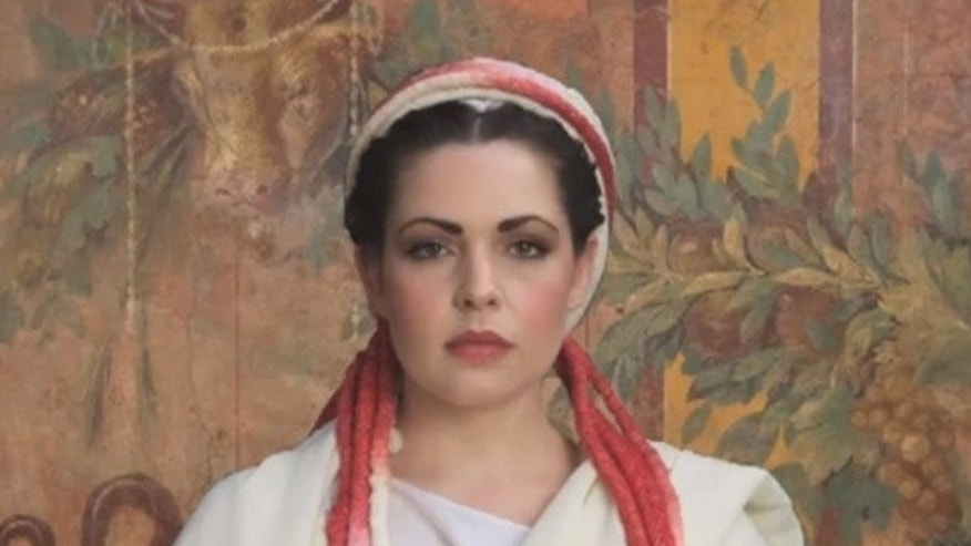 A modern woman models the Roman Vestal Virgin hairstyle and headdress.