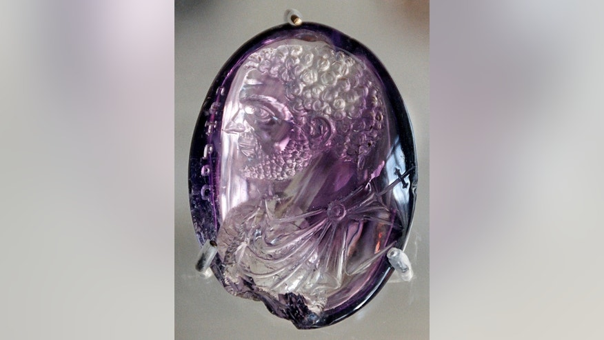 This is a Roman intaglio, or engraved gem, dating from A.D. 212 and held in the treasury of the Sainte-Chapelle in Paris. Intaglios similar to this were sometimes found in roman bath drains.