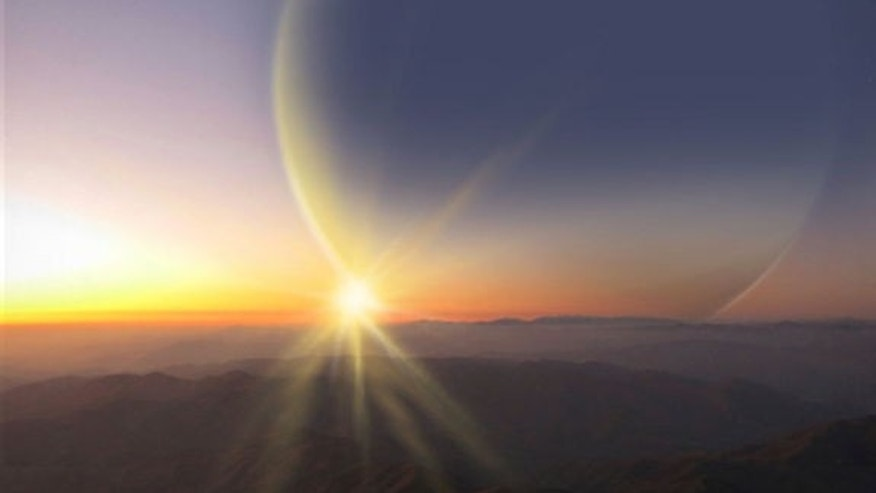 This artist's Impression depicts the view from a moon around newly found planet PH2 b.