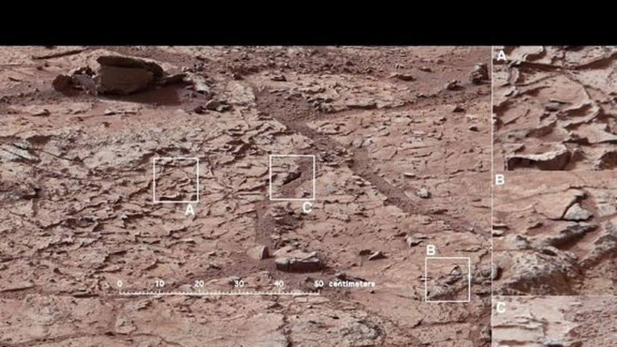 This view shows the patch of veined, flat-lying rock selected as the first drilling site for NASA's Mars rover Curiosity. Image released Jan. 15, 2013.