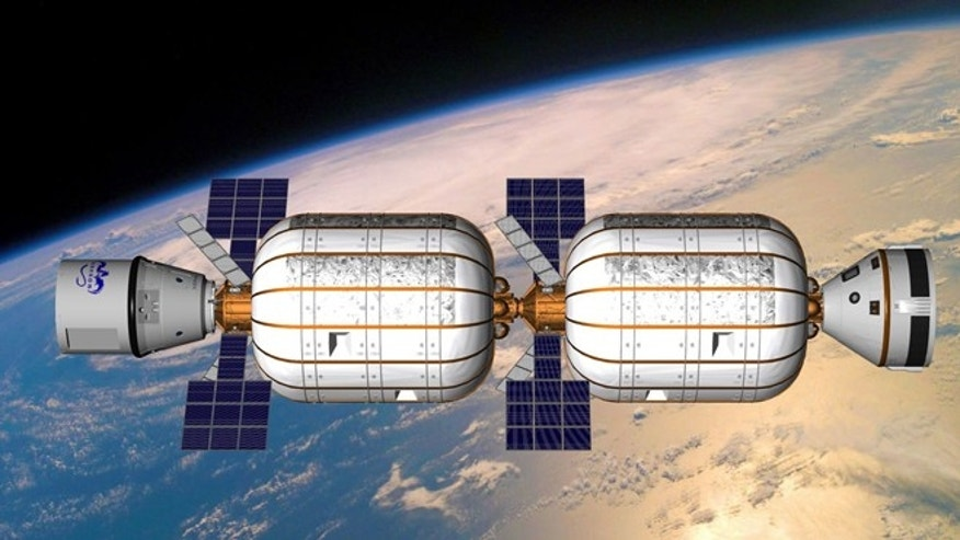 Artists view of the Bigelow Alpha Station comprised of two BA 330 expandable habitats built by private spaceflight company Bigelow Aerospace.