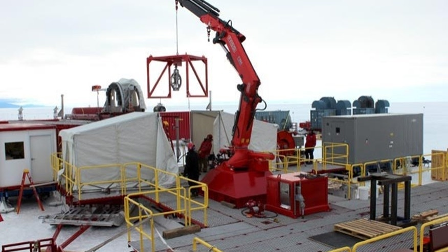 Dec., 2012: The drill set up at the WISSARD test site near McMurdo Station. The crane lifts the load transfer case that holds the scientific instruments in place over the borehole. The platform and equipment arrived at the subglacial Lake Whillans field site this week.