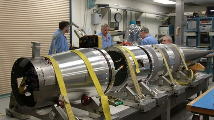NASA scientists work on a sounding rocket slated to launch on Jan. 29, 2013, to create potentially dazzlingly bright red streaks in the night sky over the U.S. East Coast. The mission will launch from NASA's Wallops Flight Facility in Virginia.