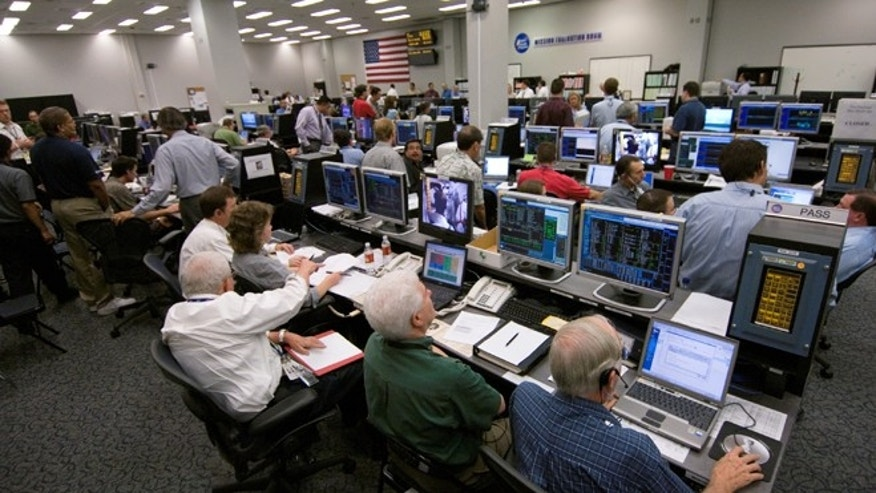 A scene from near the rear of the Mission Evaluation Room of Houston's Mission Control Center (MCC) prior to Discovery's July 2006 launch.