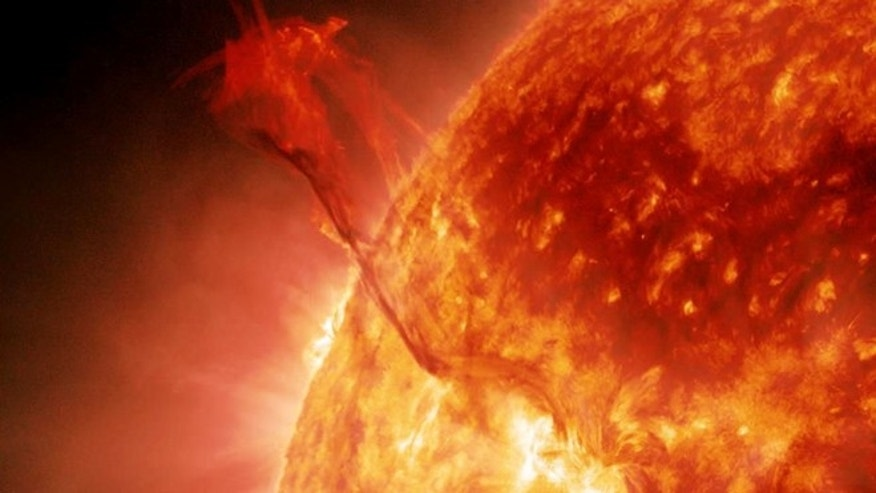 "Jan. 31, 2013: A huge filament of super-hot plasma, nicknamed the ""Dragon Tail,"" erupts from the sun in this still image from NASA's Solar Dynamics Observatory."