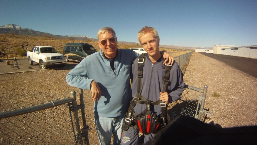 This Dec. 2012 photo provided by Jonathan Clark shows Dr. Jonathan Clark, husband of Columbia astronaut Laurel Clark, standing with his son, Iain Clark, 18, in Arizona. Clark's wife and six other astronauts were killed aboard the space shuttle Columbia on Feb. 1, 2003.