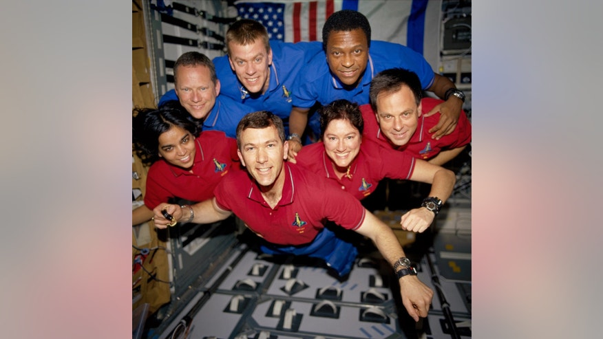 A June 2003 photo shows STS-107 crew members, from the left (bottom row) are astronauts Kalpana Chawla, mission specialist; Rick D. Husband, mission commander; Laurel B. Clark, mission specialist; and Ilan Ramon, payload specialist. From the left (top row) are astronauts David M. Brown, mission specialist; William C. McCool, pilot; and Michael P. Anderson, payload commander.