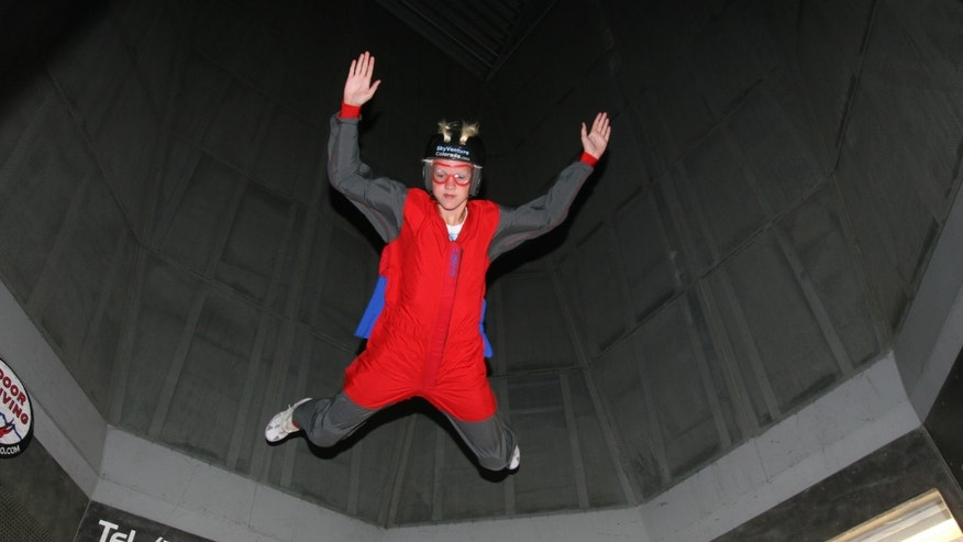 This Dec. 2012 photo provided by Jonathan Clark shows Iain Clark at an indoor skydiving center in Denver. Clark's mother was killed aboard the space shuttle Columbia on Feb. 1, 2003. Iain is set to graduate this spring from a boarding school in Arizona; he wants to study marine biology at a university in Florida.