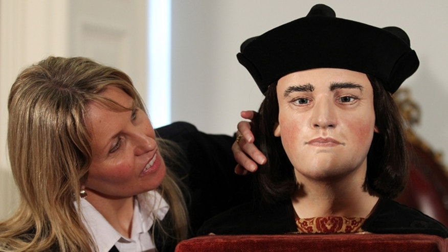 Feb. 5, 2013: Philippa Langley, originator of the 'Looking for Richard III' project, looks at a facial reconstruction of Richard III in London. He was king of England, but for centuries he lay without shroud or coffin in an unknown grave, and his name became a byword for villainy.