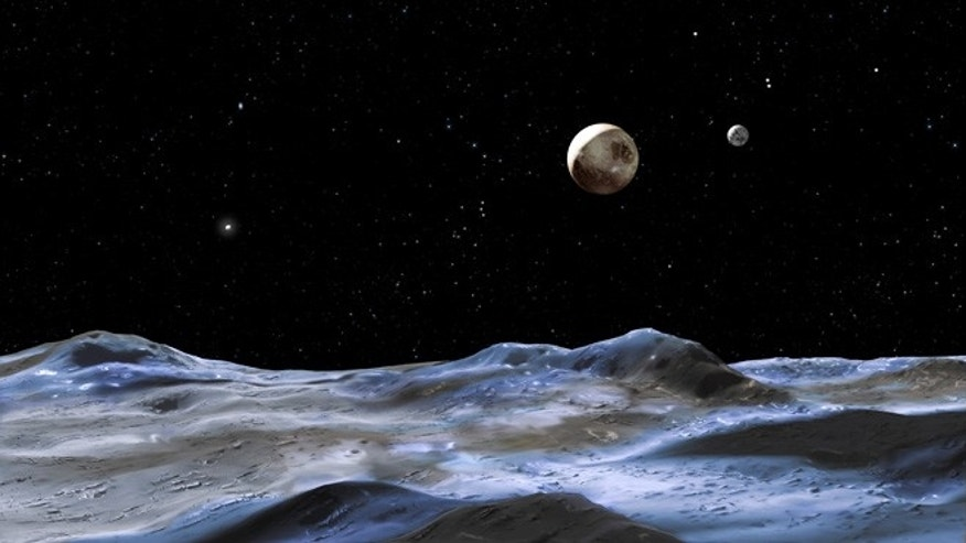 The artist's concept shows some of the Pluto system from the surface of one of its moons, Nix. Pluto itself is the large disk at center, right. Charon is the smaller disk to the right of Pluto, Hydra the bright dot on Pluto's far left.