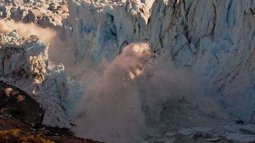 The immediate aftermath of the rupturing of an ice bridge connected to Argentina's Perito Moreno glacier, causing an enormous splash in the lake below.