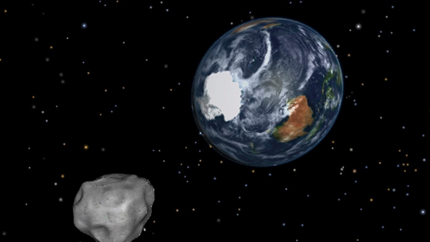 Feb. 15, 2013: This image provided by NASA/JPL-Caltech shows a simulation of asteroid 2012 DA14 approaching from the south as it passes through the Earth-moon system. The 150-foot object will pass within 17,000 miles of the Earth. NASA scientists insist there is absolutely no chance of a collision as it passes.