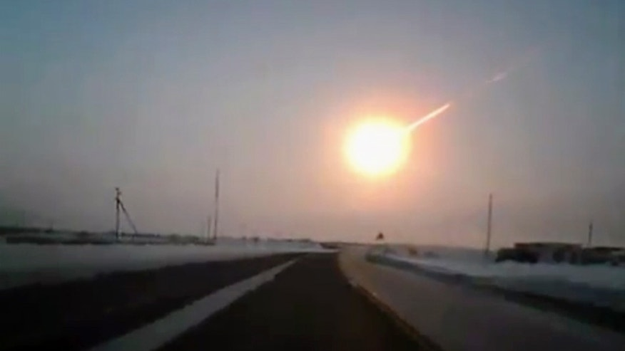 Feb. 15, 2013: In this frame grab made from a dashboard video camera, a meteorite contrail is seen streaking across the sky.
