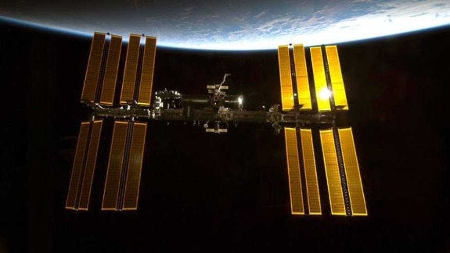 This image from a NASA space shuttle mission shows the International Space Station in orbit. The space station is the size of a football field and home to six astronauts. Image taken: Feb. 10, 2010.