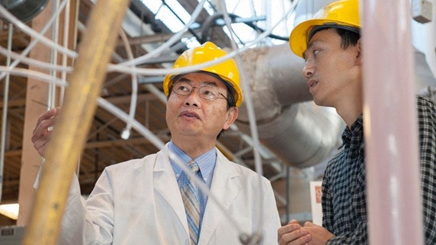 At Ohio Stateâs Clean Coal Research Laboratory, Liang-Shih Fan (left), professor of chemical and biomolecular engineering, examines a sub-pilot scale combustion unit with Dawei Wang (right), a research associate and team leader in the lab.