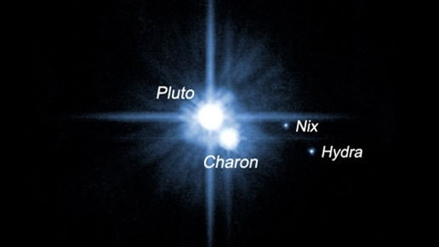 A pair of small moons orbiting Pluto named Nix and Hydra were discovered by NASA's Hubble Space Telescope in 2005. The two moons are roughly 5,000 times fainter than Pluto and are about two to three times farther from Pluto than its large moon,, Charon, which was discovered in 1978.