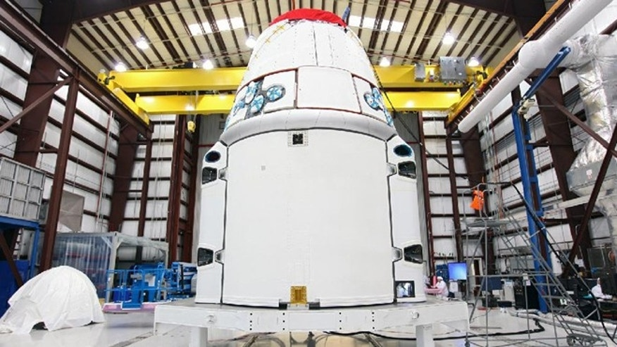 Jan. 15, 2013: The Space Exploration Technologies, or SpaceX, Dragon spacecraft stands inside a processing hangar at Cape Canaveral Air Force Station, Fla.