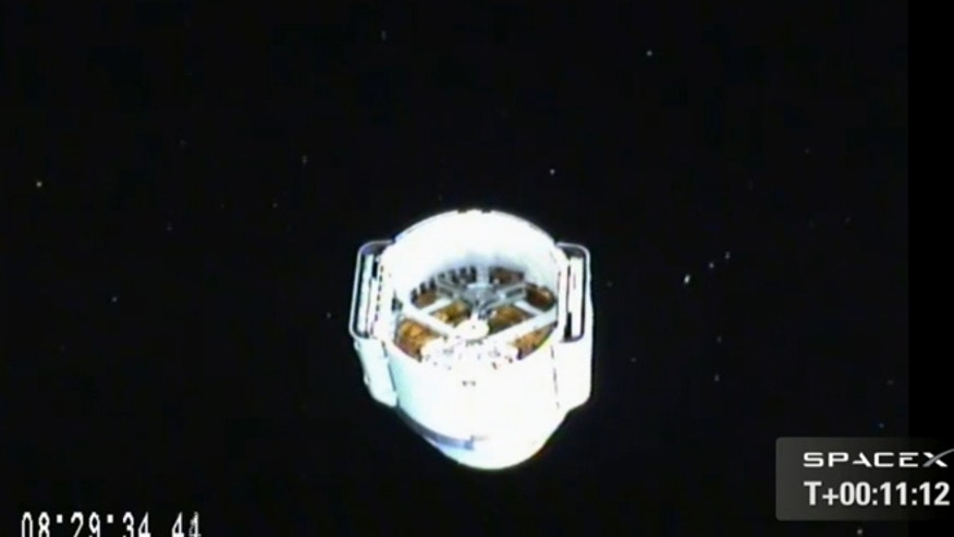 March 1, 2013: SpaceX's Dragon space capsule is seen from a camera aboard its Falcon 9 rocket after separating from the booster following its launch toward the International Space Station.