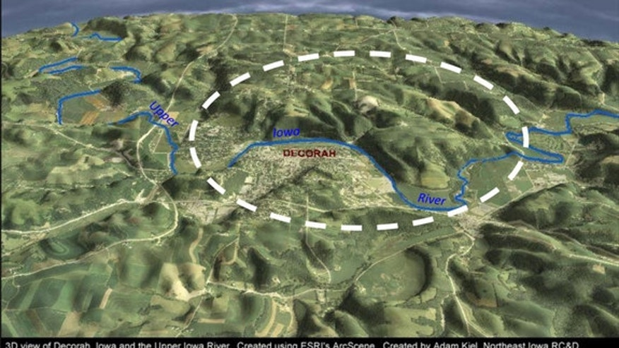 A three-dimensional view of Decorah, Iowa, and the Upper Iowa River with the location of the Decorah Impact Structure marked with the white dotted line. Scene is looking due north.